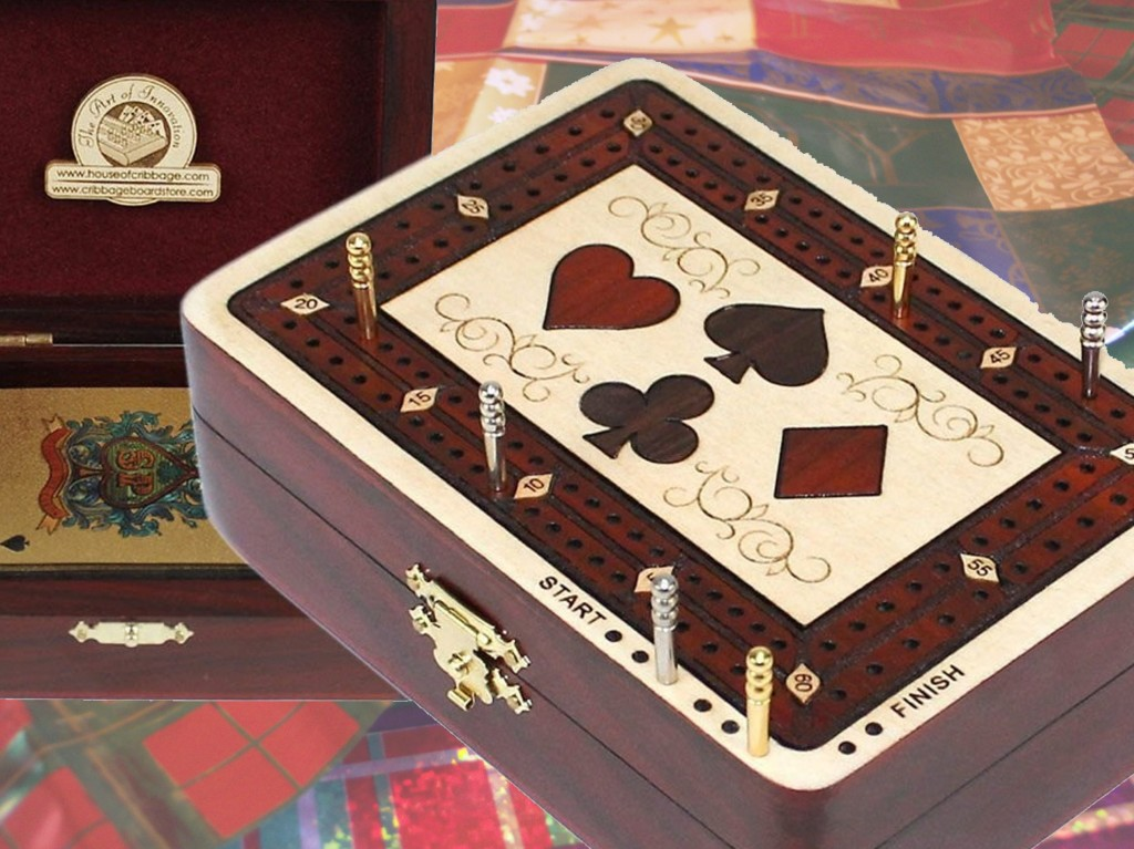 This quite affordable by The House of Cribbage 2-track, play to 61 points board is actually a storage box for playing cards, and pegging pins. Makes a great travel board.